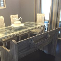 Church pew bench as dining bench and the old door as the table. this may be the coolest setup EVER! I want!