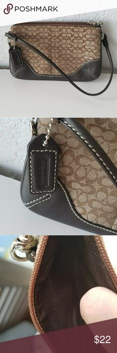 Brown/tan coach wristlet Very gently used (2or 3 times) brown/tan coach wristlet. Coach Bags Clutches & Wristlets