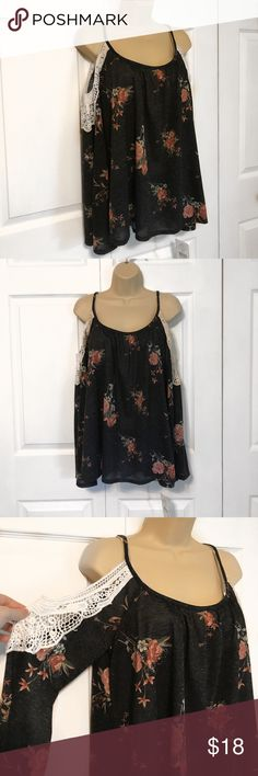 Black Floral Top with Off The Shoulder Sleeves NEW WITH TAGS! This is a very comfortable and soft shirt and it has flowers detailing the whole shirt. It also has the crochet sleeves. Let me know if you have any questions. I am also open to offers. The sleeves are also a bit flared at the end but not too drastic Rewind Tops Blouses