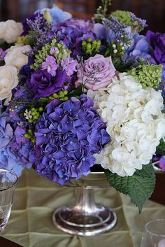 Hydrangeas & roses - purple & white- good for buffet or bar area, too big for the table