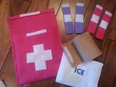 Easy DIY: 1. Felt for bag and cross 2. Hot glue gun 3. Velcro tape 4. Felt for bag of ice 5. Felt for roll up bandage 6. White felt for cotton ball
