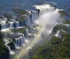 Beautiful waterfalls: Iguazu Falls, Brazil and Argentina. Larger, wider than Niagra Falls. All the pictures don't even look real. When we went there this summer, you would look around and all you would see is falls.