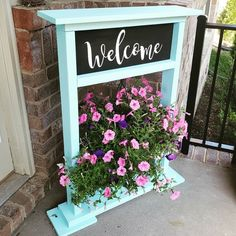 This week we made this Front Porch Hanging Flower Stand using 3 boards and our Cricut! Who doesn't love flowers to brighten up their front porch? Hanging Basket Stand, Hanging Flower Baskets, Diy Hanging Planter, Hanging Plants, Diy Wood Projects, Wood Crafts, Welcome Flowers, Diy Plant Stand, Flower Stands