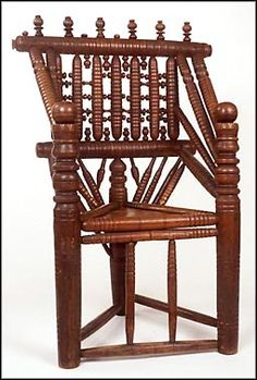 "English Renaissance Part I Harvard chair-Considered a thrown chair of the Jacobean period, the chair's structural and decorative components were turned on a lath. The base is triangular with three main supporting legs. The back rail gives the top a more square shape. Different variations of the design have a different number of spindles. Its name came from the president of Harvard university. The chair is sometimes referred to as a ""Holyoke chair"" after the first president of Harvard to use… Jacobean, Bar Stools, Harvard University, Primitives, Chair, Wood, Colonial, Renaissance, Period"