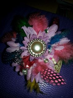 Feather flower and jewel cupcake