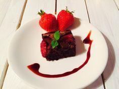 Brownie with strawberries.
