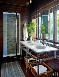 The master suite's bath is appointed with an Urban Archaeology marble-top vanity and sink and shower fittings by Michael S. Smith for Kallista