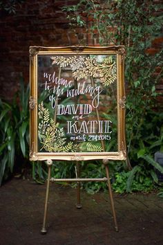 This gilded glass frame wedding sign is the perfect accent to any woodland wedding.