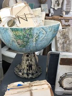 We love the idea of halting a globe and using it as a centerpiece! You could even use the other half as a shade for a hanging lamp! Genius!