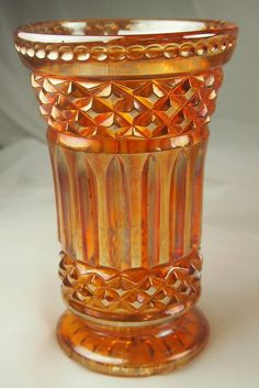 Marigold Carnival Glass Vase circa.1930s Perfect for your glass collection or to display some simple blooms. There is a small chip on the base which can be hidd