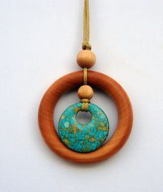 Natural wood teething/nursing pendant. I have a few from this seller and they are really great for keeping little hands occupied and it's always with you!