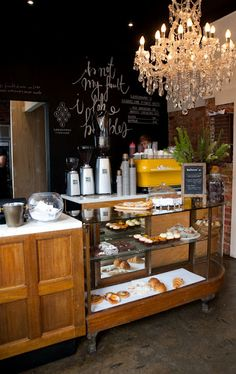 Yes, it's a cafe, but I want to steal these ideas for my (future) kitchen: blackboards, chandeliers, wood..