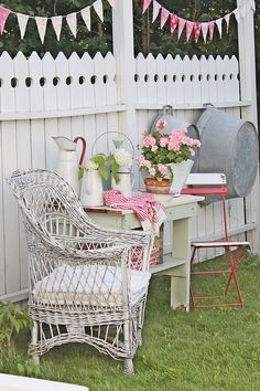 Old wicker chair out on the lawn with cottage decor