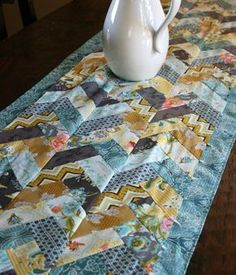 Creative Bari J. has a self imposed a 14 day challenge using LillyBelle. This completed braided table runner included Aurifil too! We look forward to more of the beautiful results!  http://barij.typepad.com/my_weblog/2012/07/challenging-myself-14-days-of-lillybelle.html