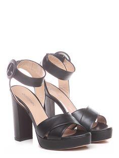 Sandalo alto in pelle con cinturino alla caviglia e suola in cuoio. tacco  120 d09d0cf570a