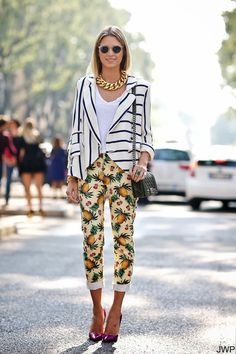 4 Pineapple Print Street Style Looks We Love Fashion Week Clear Round Sunglasses Large Chunky Chain Necklace Striped Blazer Jacket Cropped White Tee Tshirt Pineapple Printed Jeans Denim Chanel Boy Bag