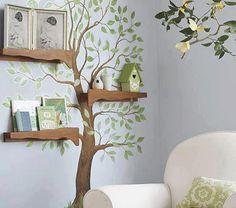 رسم شجرة على الحائط وعلى غصون بارزة خشبية لها لتضم الكتب وباقي المحتويات