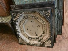 Tin ceiling panels. These make great picture frames, just cut out the middle and frame your pictures.