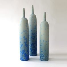 Porcelain bottles with satin matte crystalline glaze by Ted Secombe