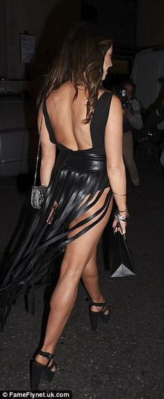 Daring:Pascal Craymer turned heads in her racy leather look which featured some barely th...