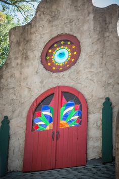 A beautiful stained glass window tucked into a roofline in Sherwood Forest at the Texas Renaissance Festival.