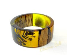 Bracelet made of aged wood piece, pine cone, thistle and resin created by Oksana Bell. Very unique, organic shape bracelet, handmade, quality work!