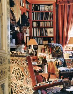 Books just seem bohemian to me, but what really makes this space tend in that direction is the rug/tapestry on the chairs.