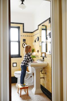 A few simple steps is all it takes to get your vintage bathroom from dated to adorable! Check out our black and yellow tile bathroom makeunder with Lowe's! Black Tile Bathrooms, Vintage Bathrooms, Bathroom Faucets, Small Bathroom, Bathroom Yellow, Bathroom Shelves, Modern Bathroom, Bathroom Ideas, Yellow Tile
