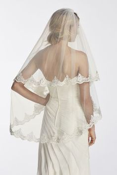 """Elegant two tier corded lace edge veil.  First tier: 30"""". Second tier: 43"""".  To care for your veil, hang and steam.  Imported."""