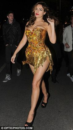Kelly Brook smoulders in a gold chainmail basque.