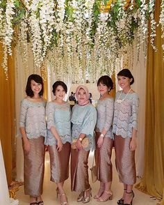 From the wedding of #ryanshadza, here's a #FriendsofTBBF post of their lovely bridesmaids. The combination of aqua colored lace top and bronze hued songket builds a sweet and chic finish to the girls' look! Who loves the color combo too? Tag your future bridesmaids below!  Photo via @mdnthbr