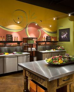 Prominent sequence of exaggerated, whimsical painted scroll motifs that are influenced by the tradition Tuscan scroll patterns that originate in antiquity but have a distinct contemporary flare.    Winner: Best in Show, 2007 ASID Arizona North Chapter Design Excellence Awards. Winner: 1st Place Commercial Retail Space, 2007 ASID Arizona North Chapter Design Excellence Awards
