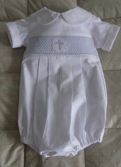 This hand smocked baby baptism outfit the outfit can be made in size 3 months to 24 months.The smocking design is of a center cross surrounded by a geometric pattern. The outfit buttons in the back and it has a button bottom seam for quick diaper changes. Baby Dress Clothes, Baby Boy Dress, Baby Boy Outfits, Kids Outfits, Baby Boy Christening Outfit, Baby Baptism, Smocks, Baby Wearing, Heirloom Sewing