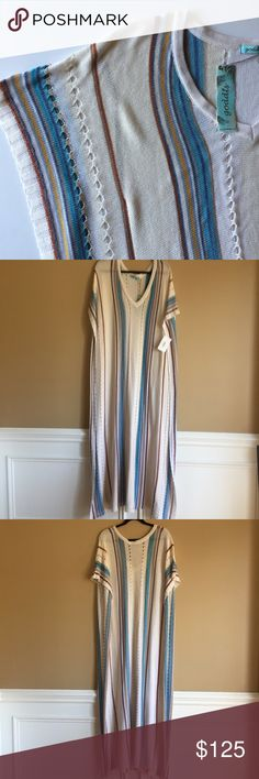 NWT Stunning Goddis Rika Dress/ Kaftan Size Small The knit Goddis Kaftan is crafted with 50% Cotton and 50% Acrylic. Deep sleeves, V Neck and beautiful vertical details. Retails for $216 Goddis Dresses Maxi