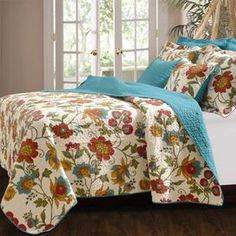 "Brimming with the appeal of a lavish garden, this reversible cotton quilt set showcases a charming and colorful floral motif.   Product:   Twin: 1 Quilt and 1 standard sham   Full/Queen: 1 Quilt and 2 standard shams King: 1 Quilt and 2 king shams Construction Material:  CottonColor: MultiFeatures: Floral motifReversible Oversized for better mattress coverageDimensions:  Standard Sham: 20"" x 26"" Twin Quilt: 68"" x 88""  Full/Queen Quilt: 90"" x 90""King Sham: 20"" x 36""   King Quilt: 105"" x ..."