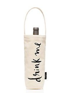 "foldable and festive, this canvas wine tote makes carrying your favorite bottle of prosecco a snap. printed with ""drink me"" on the front, we'll be using it all season as a gift for the holiday dinner hostess and to tow a bit of bubbly to a new year celebration."