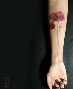 Gilberta Vita flower tattoo