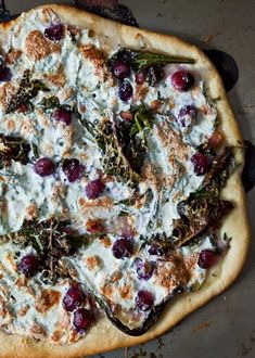 Amanda Hesser, has shared her recipe for Kale, Pancetta and Grape Pizza.* Though this didn't seem like a likely combination, the strong kale with the salty bacon and the pecorino contrast with the sweet grapes and mild mozzarella make for an oh-so interesting eat.