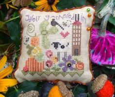 Safely Gathered is the title of this cross stitch kit from Shepherd's Bush that you finished as a pin cushion.