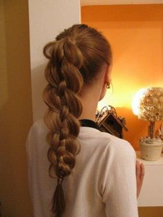 Pony tail, then braid. Then tease out the two outer strands leaving the center one straight.