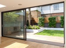 Simple landscaped city garden with large sliding doors at the end of the house. - March 09 2019 at Aluminium Sliding Doors, Sliding Patio Doors, White Bifold Doors, Aluminium Windows, Front Doors, Garden Ideas Large, Deco Surf, Slider Door, Door Images