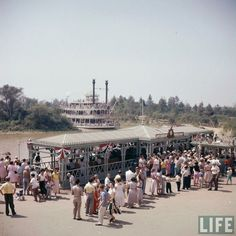 "disneylandguru: ""Disneyland 1955, Mark Twain dock on opening day, from the Life Magazine archive. Color corrected by United Style"""
