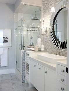 Nice idea cutting out the wall to let more light in the shower. Cool sink and mirror