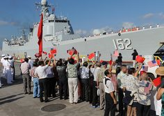 All sizes | Chinese citizens wave flags as the People's Liberation Army-Navy ships arrive in Hawaii | Flickr - Photo Sharing!