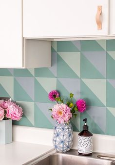This DIY budget backsplash idea has the look and feel of popular, patterned cement tiles without the price tag. This entire backsplash costs less than $50!