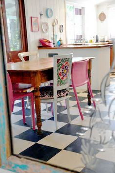 adore the upholstered chair (and the black and white tile, too)