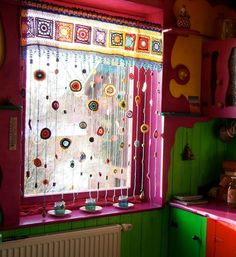 An amazing crocheted window treatment that's like a rainbow-y halo-y light-streaming day dream! Except it's real. decor diy window treatments The crocheted window treatment of your rainbow daydreams Crochet Curtains, Beaded Curtains, Crochet Curtain Pattern, Hippie Curtains, Crochet Home, Crochet Crafts, Window Coverings, Window Treatments, Deco Boheme