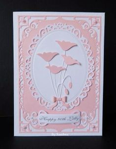 By Sandma - Memory Box Prim Poppy and Tiny Bow dies mounted on Spellbinders Decorative Oval and Elegant Labels Four dies.