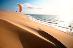 paragliding on the coast of Mozambique at sunset