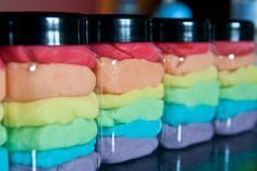 Homemade rainbow playdough, used as party favours. Great idea from nicolehastings.com